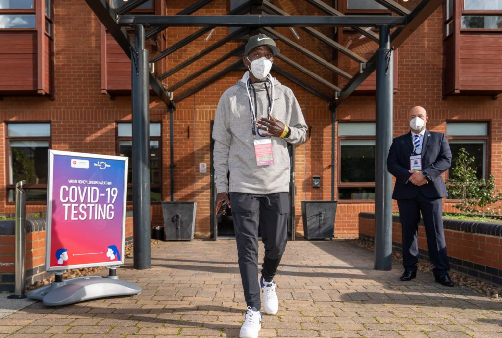 Kenya's Eliud Kipchoge walks out of the Covid-19 testing area after entering the bio-secure bubble for the elite-only 2020 London Marathon (Photo: Bob Martin for London Marathon Events)